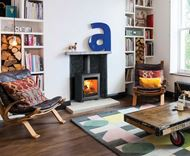 Contemporary living room. Lots of light. Aspect 4 Compact wood stove.